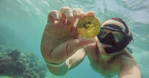 Im Urlaub mit Bitcoins bezahlen